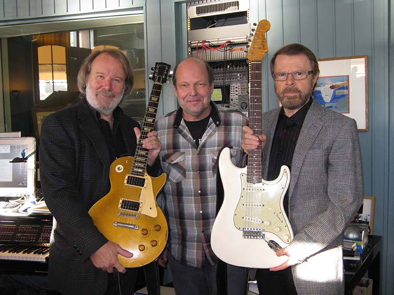 Lasse Wellander together with Björn and Benny and his faithful old servants, a Les Paul -57 and a Strat -62